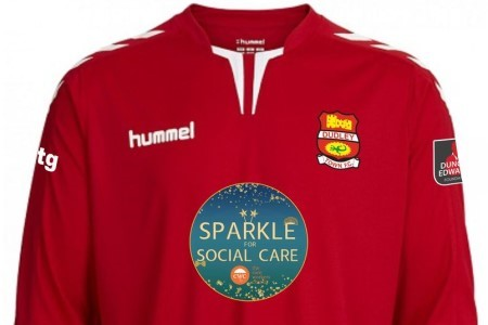 Football club gets kicks from carer support strip