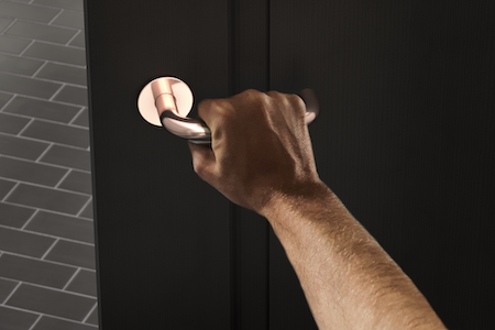 ProEconomy uses a copper touch to handle door furniture